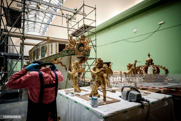 This picture taken on on September 19 2018 shows undergoing renovation work on France's Imperial Canoe of Napoleon I before being transferred from...