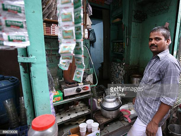 This picture taken on Saturday August 1 2009 shows the tea stall of Kamal Kishore outside the dilapidated Haksar Haveli at Sita Ram Bazar Chandni...