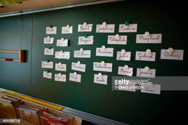This picture taken on September 1 2014 shows names on a blackboard in a primary school of the ninth arrondissement of Paris on the eve of the first...