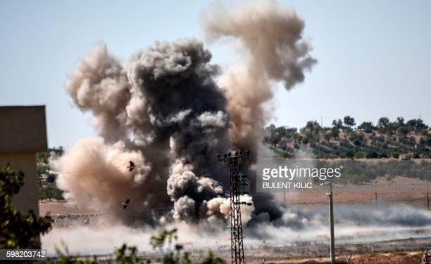 TOPSHOT This picture taken on September 1 2016 in the TurkishSyrian border town of Karkamis in the southern region of Gaziantep shows smoke rising...
