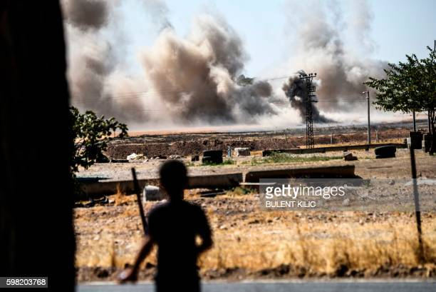 TOPSHOT This picture taken on September 1 2016 in the TurkishSyrian border town of Karkamis in the southern region of Gaziantep shows a boy looking...