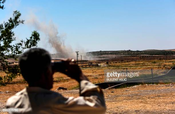 TOPSHOT This picture taken on September 1 2016 in the TurkishSyrian border town of Karkamis in the southern region of Gaziantep shows a man looking...