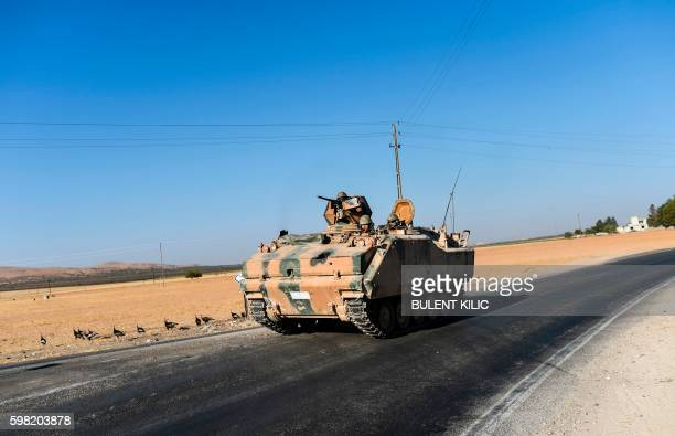 TOPSHOT This picture taken on September 1 2016 in the TurkishSyrian border town of Karkamis in the southern region of Gaziantep shows a Turkish army...