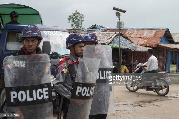 This picture taken on September 1 2017 shows Myanmar police standing guard at an Internally Displaced Persons camp in Sittwe Rakhine State UN chief...