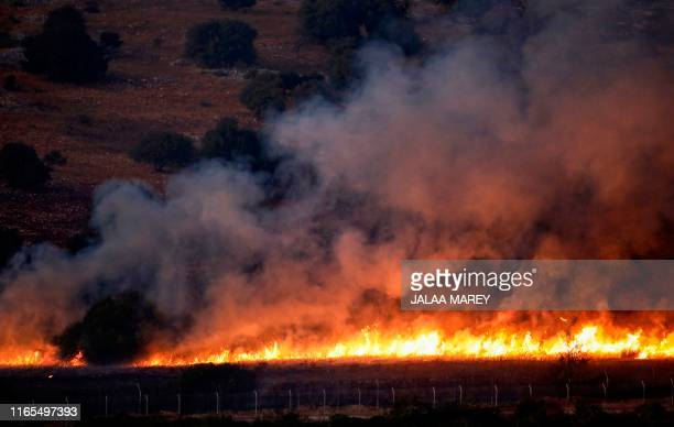 This picture taken on September 1 2019 from a location near the northern Israeli town of Avivim shows a fire blazing in a field along the border with...