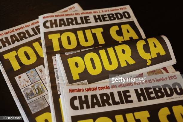 """This picture taken on September 1, 2020 in Paris shows covers of French satirical weekly Charlie Hebdo reading """"All of this, just for that,"""" to be..."""