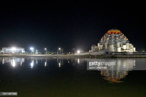 This picture taken on September 10 2018 shows a floating threestorey mosque with a double blue dome which can house around 500 people along Losari...