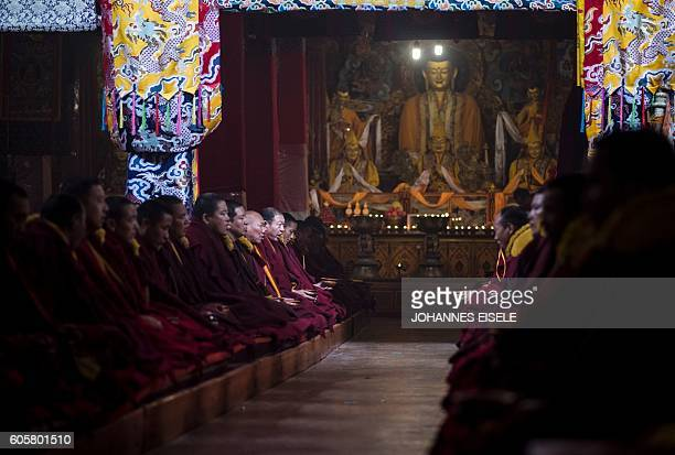 This picture taken on September 11 2016 shows monks sitting and praying in the Buddhist Sera monastery in the regional capital Lhasa in China's Tibet...