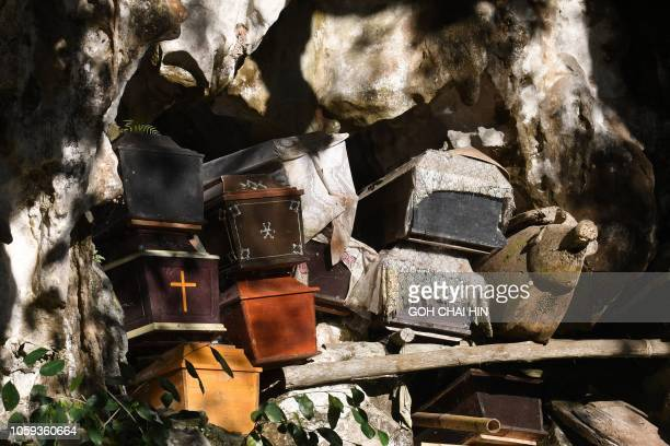 TOPSHOT This picture taken on September 11 2018 shows coffins at the entrance to a burial cave in Londa in Tana Toraja regency Torajans an ethnic...