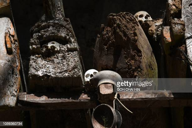 This picture taken on September 11 2018 shows coffins at the entrance to a burial cave in Londa in Tana Toraja regency Torajans an ethnic group that...