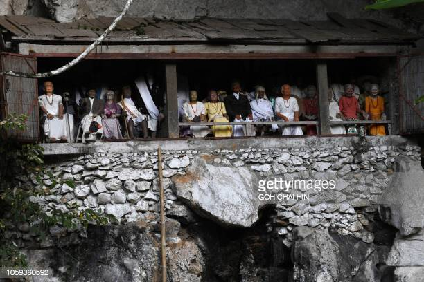 This picture taken on September 11, 2018 shows the entrance to a burial cave in Londa in Tana Toraja regency, where wooden dolls known as Tau Tau are...