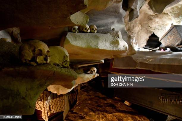This picture taken on September 11 2018 shows the remains of bodies interned in a burial cave in Londa in Tana Toraja regency Torajans an ethnic...