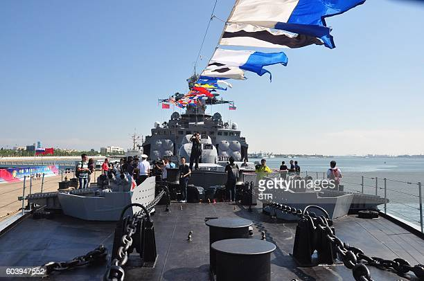 This picture taken on September 12 2016 shows Chinese journalists touring a Russian navy ship at Zhanjiang port in Chinas southern Guangdong province...