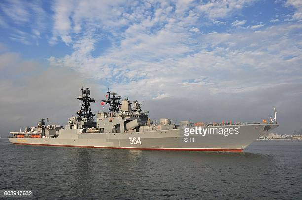 This picture taken on September 12 2016 shows the Russian destroyer Admiral Tributs arriving at Zhanjiang port in Chinas southern Guangdong province...