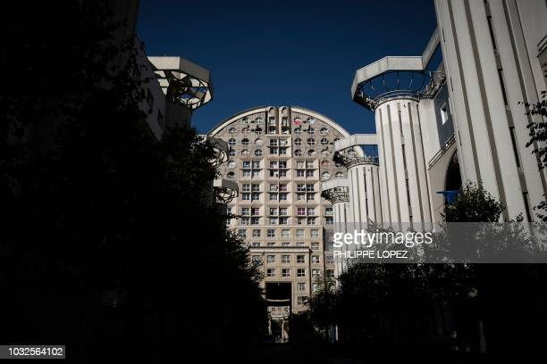 This picture taken on September 12 2018 shows one of the two buildings with a cylindrical form designed by Spanish architect Manolo Nunez Yanowsky in...