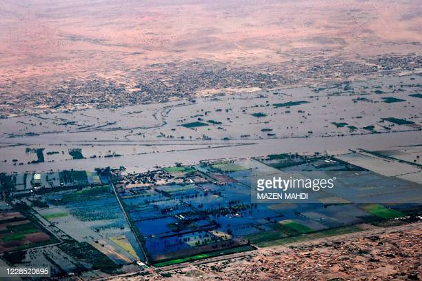This picture taken on September 14, 2020 aboard an aircraft of the Bahrain Royal Charity Organisation shows an aerial view of flooded parts of...