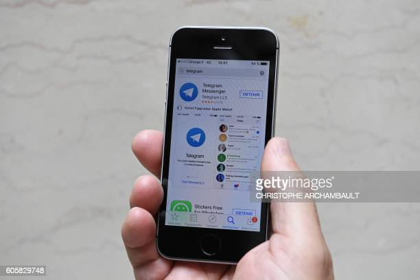 This picture taken on September 15 2016 in Paris shows the Telegram messenger application on a smartphone Smartphone app Telegram favoured by the...