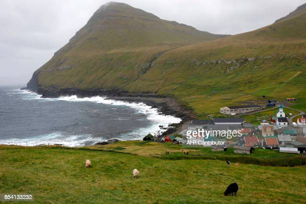 This picture taken on September 15 shows Gjogv village in Eysturoy one of the 18 Faroe Islands located between the North Atlantic Ocean and Norwegian...