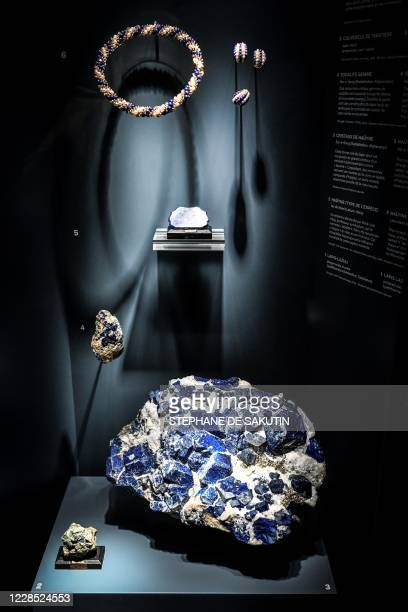 This picture taken on September 15 shows precious stones and jewellery displayed at the Grande Galerie de l'Evolution of the Museum d'Histoire...
