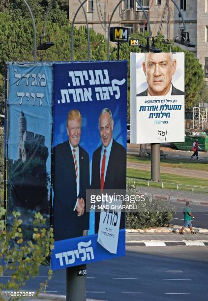 This picture taken on September 16 2019 shows Israeli election billboards in a street in Jerusalem for the Likud party showing US President Donald...