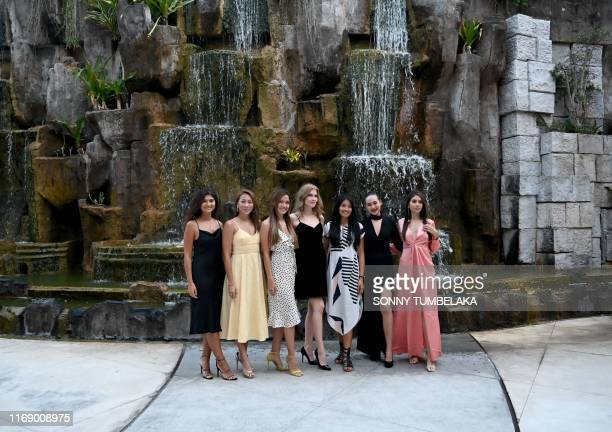 This picture taken on September 17 2019 shows Miss World contestants from 2015 from Narissara Nena France of England Vanessa Tevi of Malaysia Claudia...