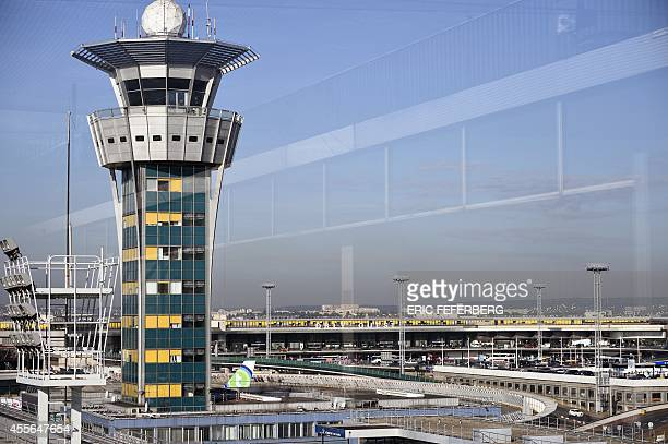 This picture taken on September 18 2014 shows the control tower at Orly's airport near Paris French flag carrier Air France was forced to scrap...