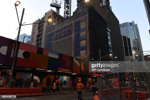This picture taken on September 18 2017 shows an advertisement of an old iconic Australian brand 'Peapes' seen after demolition of a tower block on...
