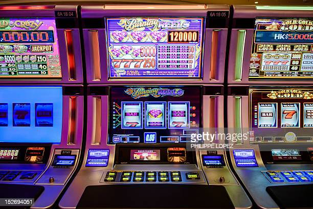 This picture taken on September 19 2012 shows gambling machines in of the Cotai new Sands casino in Macau Las Vegas casino boss Sheldon Adelson...