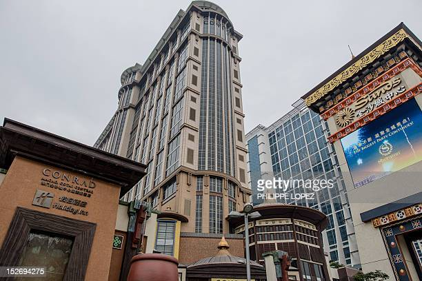 This picture taken on September 19 2012 shows new Conrad hotel and the new Sheraton hotel housing the Sands casino in Cotai in Macau Las Vegas casino...