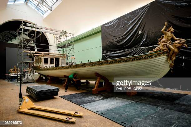 This picture taken on September 19 2018 shows France's Imperial Canoe of Napoleon I next to a huge breach to be pierced in the wall of the Palais de...