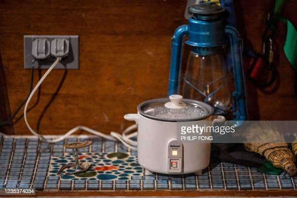 This picture taken on September 19, 2021 shows a rice cooker plugged in inside campervan enthusiast Takayuki Minagawa's 1964 Volkswagen Type 2 at a...