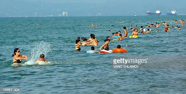 MAINVILLE* This picture taken on September 2 2010 shows people swimming at a beach of the town of Batumi On a lush strip of Georgia's Black Sea coast...