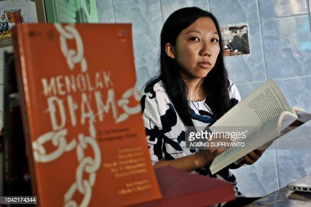 This picture taken on September 20 2018 shows Indonesian Erwiana Sulistyaningsih posing at her rented room near her university in Yogyakarta She was...