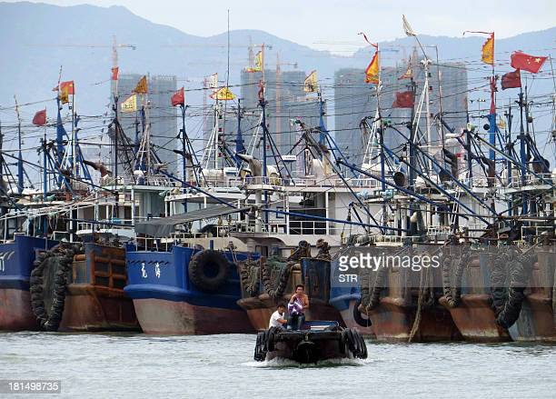 This picture taken on September 21 2013 shows Chinese fishing boats anchored at the harbour in Xiamen southeast China's Fujian province following a...