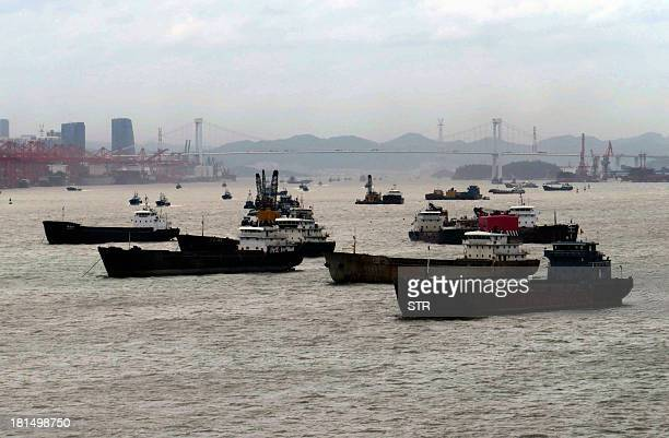 This picture taken on September 21 2013 shows Chinese ships anchored at the harbour in Xiamen southeast China's Fujian province following a typhoon...