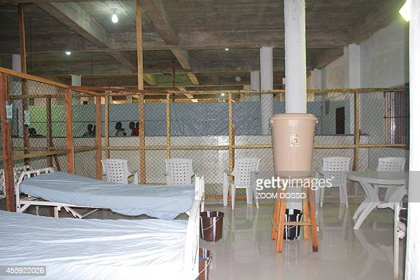 This picture taken on September 21 2014 shows beds inside the Island Clinic a new Ebola treatment centre that opened in Monrovia Liberia announced...