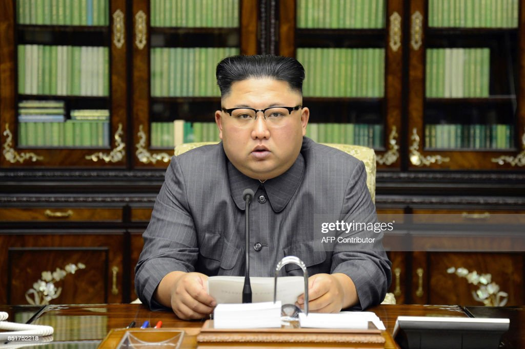 TOPSHOT - This picture taken on September 21, 2017 and released from North Korea's official Korean Central News Agency (KCNA) on September 22 shows North Korean leader Kim Jong-Un delivering a statement in Pyongyan as regards to a speech made by the president of the United States of America at the UN General Assembly. US President Donald Trump is 'mentally deranged' and will 'pay dearly' for his threat to destroy North Korea, Kim Jong-Un said, in an unprecedented personal attack published hours after Washington vowed tougher sanctions over Pyongyang's nuclear programme. / AFP PHOTO / KCNA VIA KNS / STR / South Korea OUT / REPUBLIC OF KOREA OUT ---EDITORS NOTE--- RESTRICTED TO EDITORIAL USE - MANDATORY CREDIT 'AFP PHOTO/KCNA VIA KNS' - NO