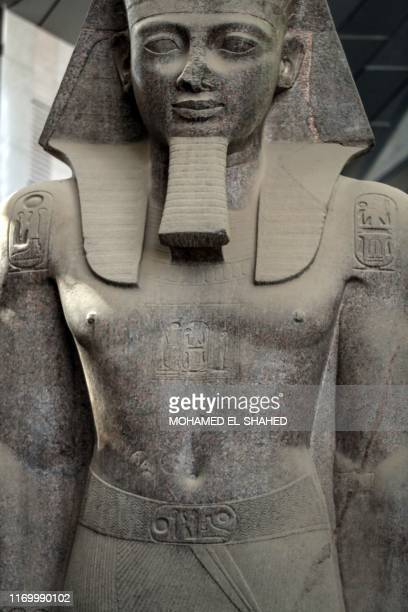 This picture taken on September 21, 2019 shows a close-up view of the colossus of ancient Egyptian Pharaoh Ramses II, at its permanent display spot...