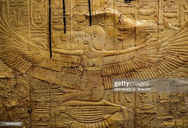 This picture taken on September 21, 2019 shows a view of reliefs on the foot of the golden sarcophagus of the ancient Egyptian Pharaoh Tutankhamun as...