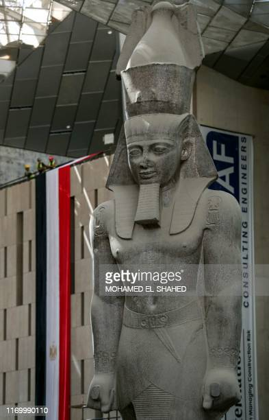This picture taken on September 21, 2019 shows a view of the colossus of ancient Egyptian Pharaoh Ramses II, at its permanent display spot in the...