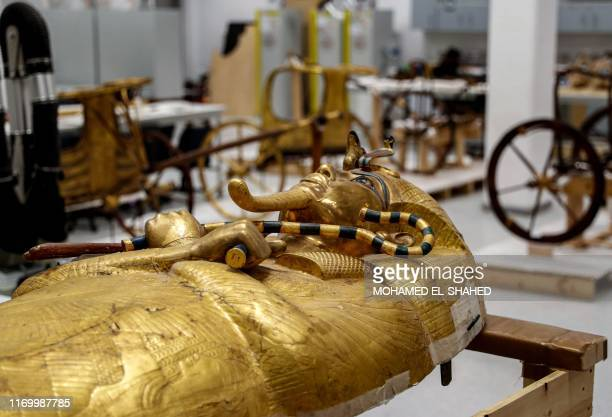 This picture taken on September 21, 2019 shows a view of the golden sarcophagus of the ancient Egyptian Pharaoh Tutankhamun as it lies for...
