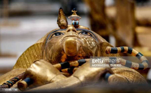 TOPSHOT This picture taken on September 21 2019 shows a view of the golden sarcophagus of the ancient Egyptian Pharaoh Tutankhamun as it lies for...