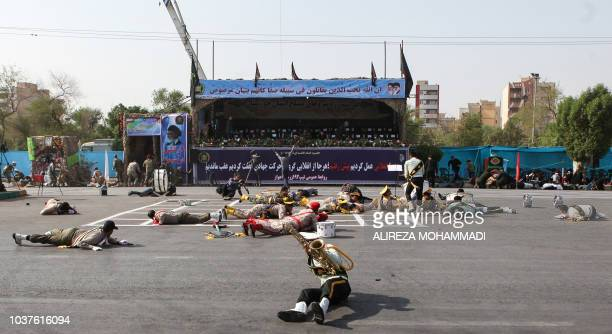 TOPSHOT This picture taken on September 22 2018 in the southwestern Iranian city of Ahvaz shows injured soldiers lying on the ground at the scene of...