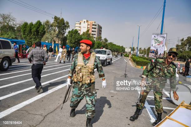 This picture taken on September 22 2018 in the southwestern Iranian city of Ahvaz shows soldiers at the scene of an attack on a military parade that...