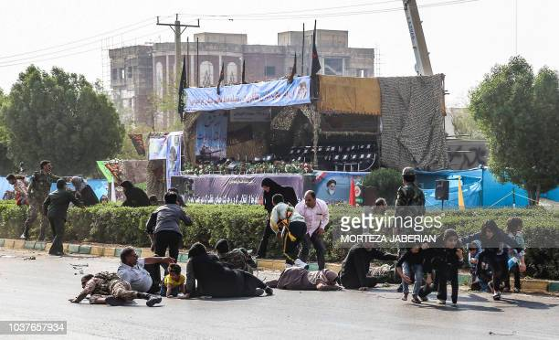 TOPSHOT This picture taken on September 22 2018 in the southwestern Iranian city of Ahvaz shows Iranian men women and children lying on ground for...
