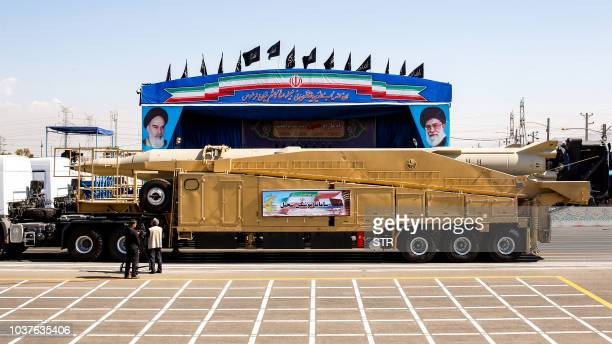This picture taken on September 22 2018 shows the longrange Iranian missile Sejil being shown during the annual military parade marking the...