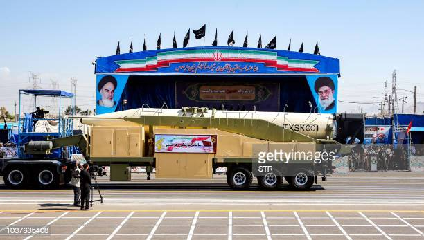 This picture taken on September 22 2018 shows the longrange Iranian missile Khoramshahr being shown during the annual military parade marking the...