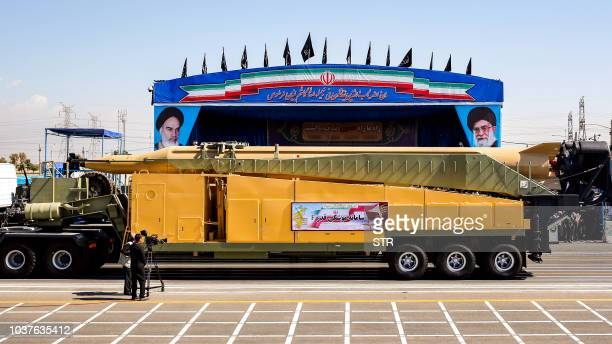 This picture taken on September 22 2018 shows the longrange Iranian missile Ghadr F being shown during the annual military parade marking the...