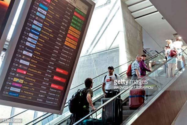 TOPSHOT This picture taken on September 23 2019 shows the cancelled flights of the Thomas Cook airlines at the Larnaca International Airport in the...