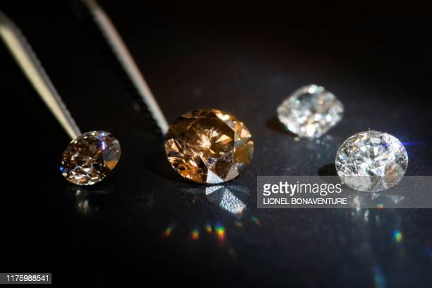 This picture taken on September 23 in Paris shows labgrown diamonds in the headquarters of the DiamConcept company Growing diamonds identical to...